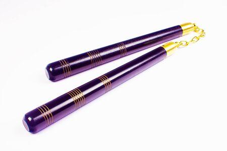 nunchaku: Purple nunchaku, the asian weapon isolated on white background.