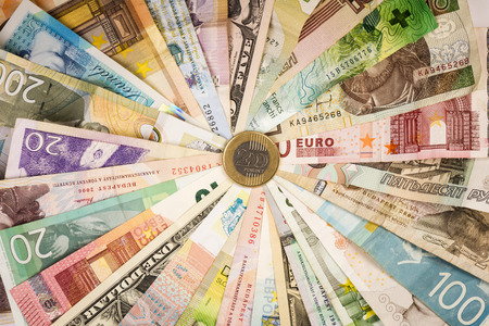 Different mixed banknotes around in circle, exchange concept.