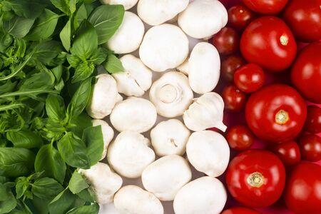 Italian flag from Italian food ingredients: basil, mushrooms, garlic, tomato.