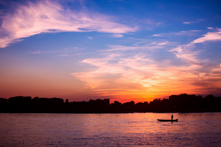 Beautiful sunset on Danube river in Serbia, landscape with sunset sky. 免版税图像