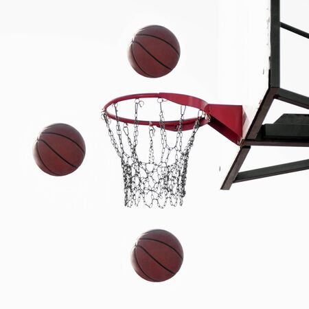 Three basketball balls are flying in the air to basket on white background, basketball sport concept.