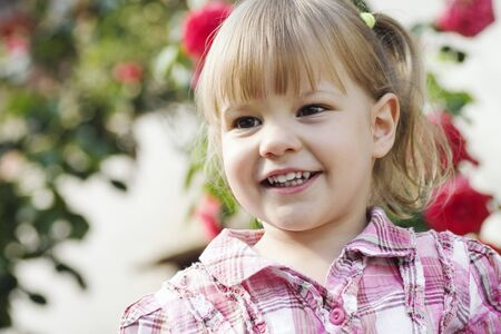Portrait of smiling cute blond hair little girl, child portrait. 写真素材