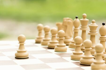 The white pawn chess piece is starting the match on the chessboard.