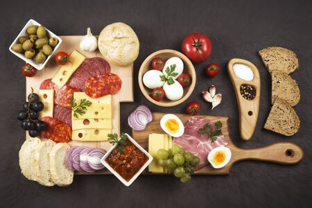 Gourmet appetizer platter or luxury breakfast tray is serving on dark gray background, food service and catering concept. 스톡 콘텐츠
