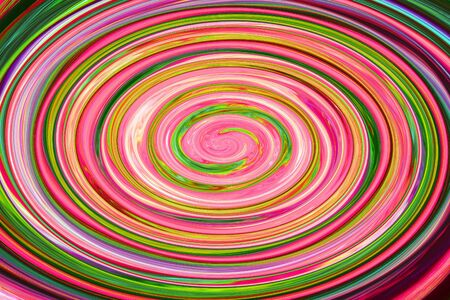 Colorful green and pink abstract spiral swirl shape.