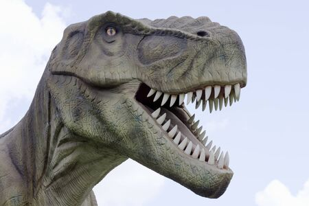Animal portrait of tyrannosaurus rex dinosaur with opened mouth and sharp teeth.