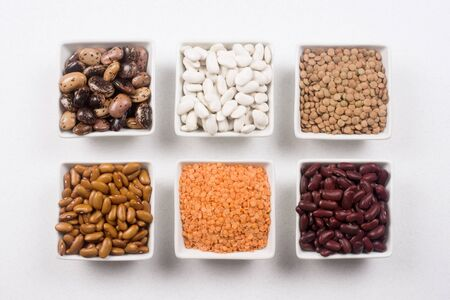 Different food ingredients from legume family like beans and lentils on white background. 스톡 콘텐츠
