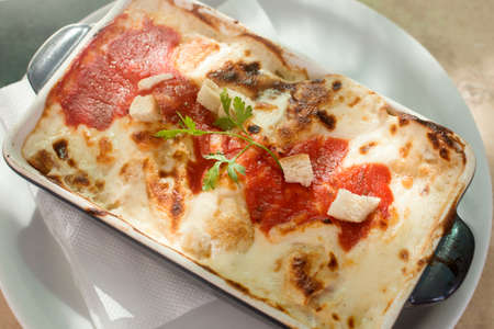 Baked pancake with cheese sauce or lasagne Italian food in restaurant.