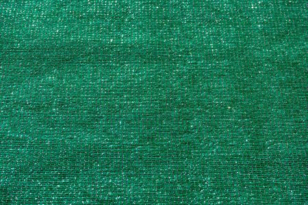 green fabric to cover a fence, privacy concept