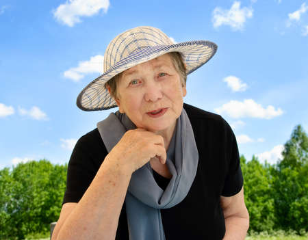 Happy senior woman outdoors in summer Stock Photo - 9365334