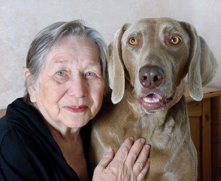 Senior woman and dog  photo