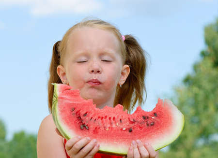 little girl eating watermelon  photo