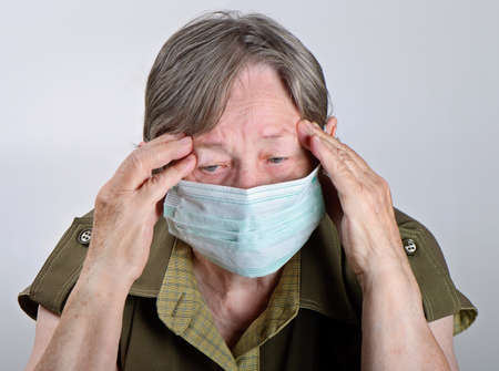 flue season: Senior woman  wearing protective mask  Stock Photo