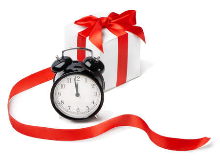 time of year: Alarm clock with gift Stock Photo