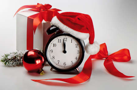 time of the year: Alarm clock with gift Stock Photo
