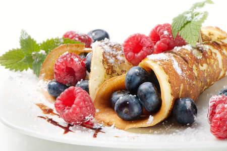 hot cakes: panqueques con frambuesas Foto de archivo
