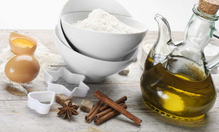 Baking Ingredients: meal,sugar,eggs,spices,olive oil photo