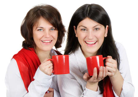 Two happy smiling young women drinking tea photo