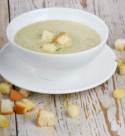 Delicious creamy vegetable soup with spinach and croutons Stock Photo