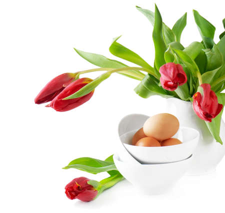 Easter eggs and tulips isolated on white background photo
