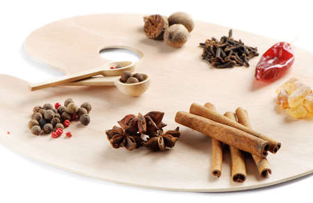 spices on a wooden palette isolated on white photo
