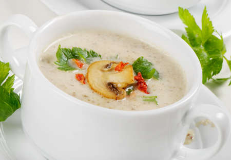 Mushroom soup with parsley photo