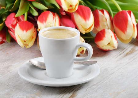 Coffee and tulips Stock Photo