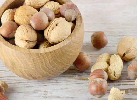 Nuts on a wooden table Stock Photo - 12984651