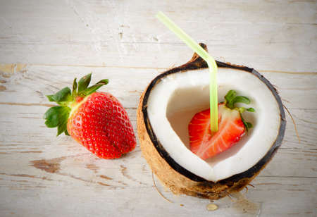 Coconut and strawberries photo