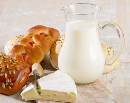 Fresh baked bread with  milk photo
