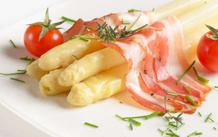 white asparagus served with ham photo