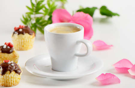 Coffee cup and muffins photo