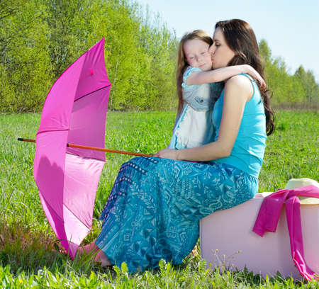 Happy mother and daughter outdoors  photo