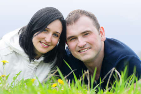 Happy young couple outdoor in spring photo