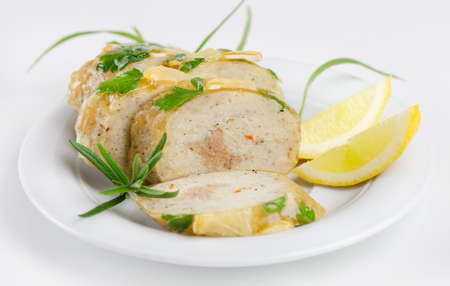 stuffed fish: stuffed fish with  on white plate