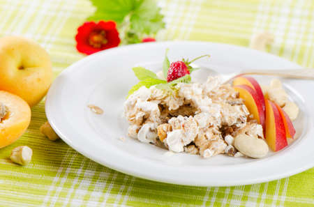 Healthy breakfast - muesli and fruits photo