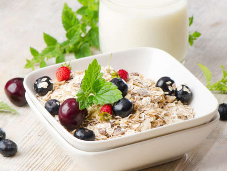 bran: Healthy breakfast - muesli, milk and berry Stock Photo