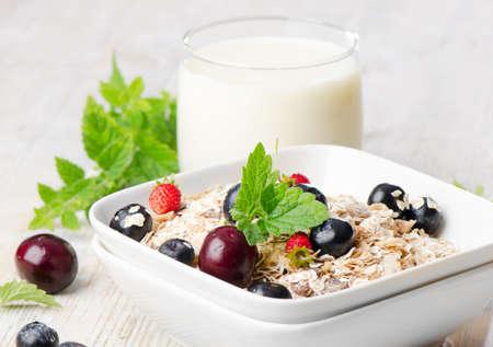 Healthy breakfast - muesli, milk and berry photo