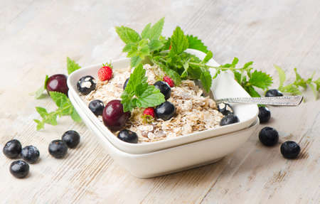 Healthy breakfast - muesli and berry photo