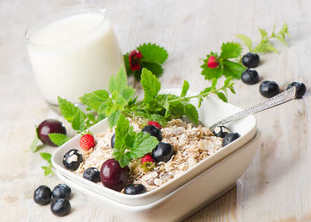 Healthy breakfast - muesli, milk and berry photo