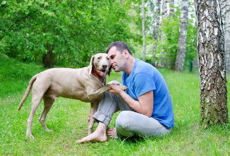 Happy man and his dog in summer photo