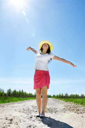 sone: Young happy woman outdoors in summer Stock Photo