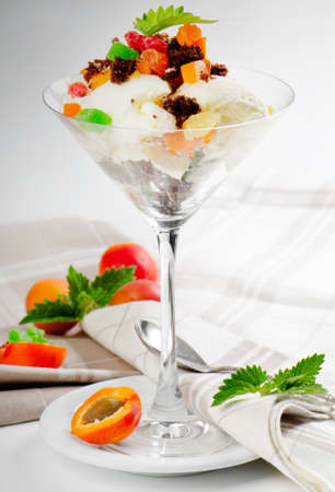 Sweet dessert with fresh apricots photo