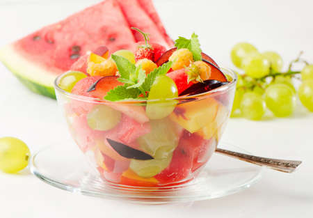 Fruit salad and fresh berries photo