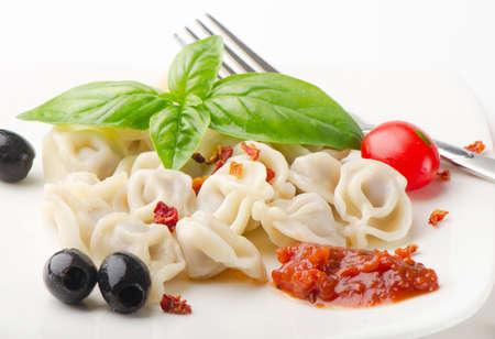 Ravioli pasta with  tomato sauce and basil photo
