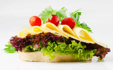 sandwich with cheese,herbs and tomatoes photo