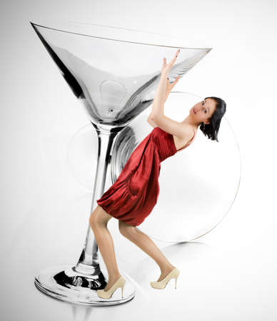 the woman holds a falling glass photo