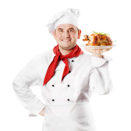 Chef showing  plate with roasted chicken isolated on white photo