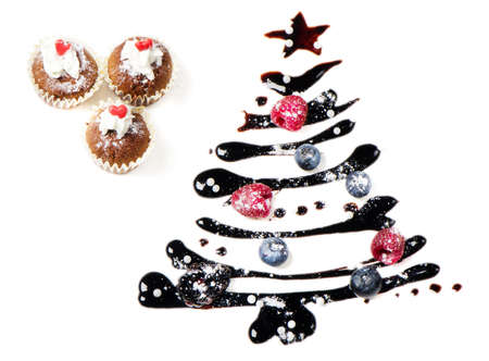 Cupcakes  and sweet  christmas tree isolated on white Stock Photo - 15300041