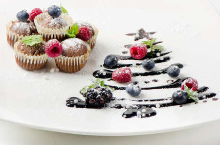Cupcakes  with fresh berries and sweet chocolate  christmas tree Stock Photo